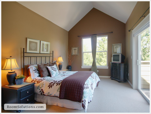 Home staging of (occupied) bedroom by Room Solutions Staging in Portland, OR