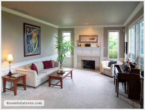 Home staging of (occupied) living room by Room Solutions Staging in Portland, OR